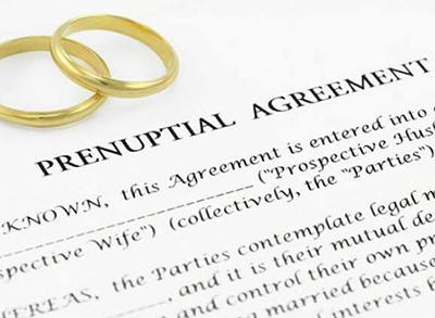 prenuptial agreement with gold wedding bands